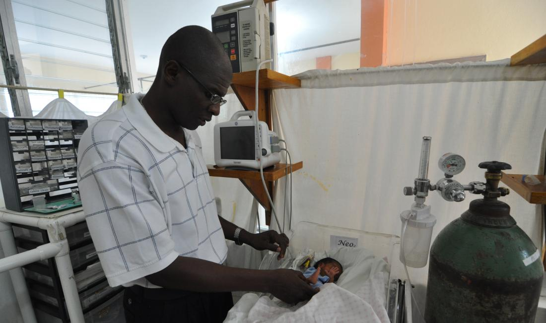 Dr. Pierre with baby in the NICU