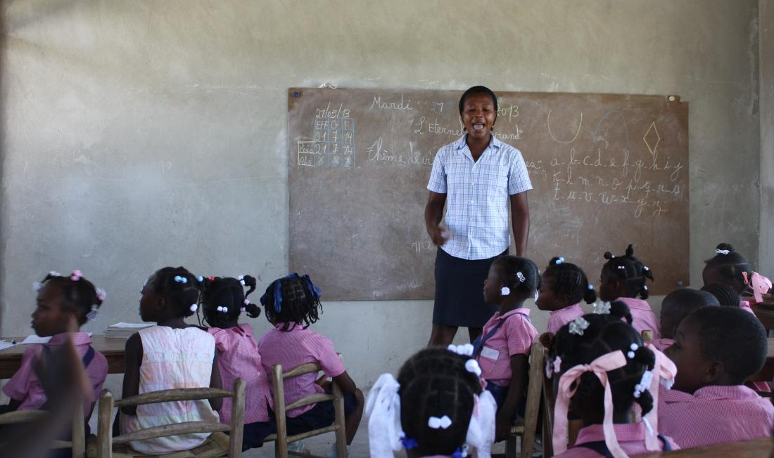 Teacher standing in front of a classroom of students