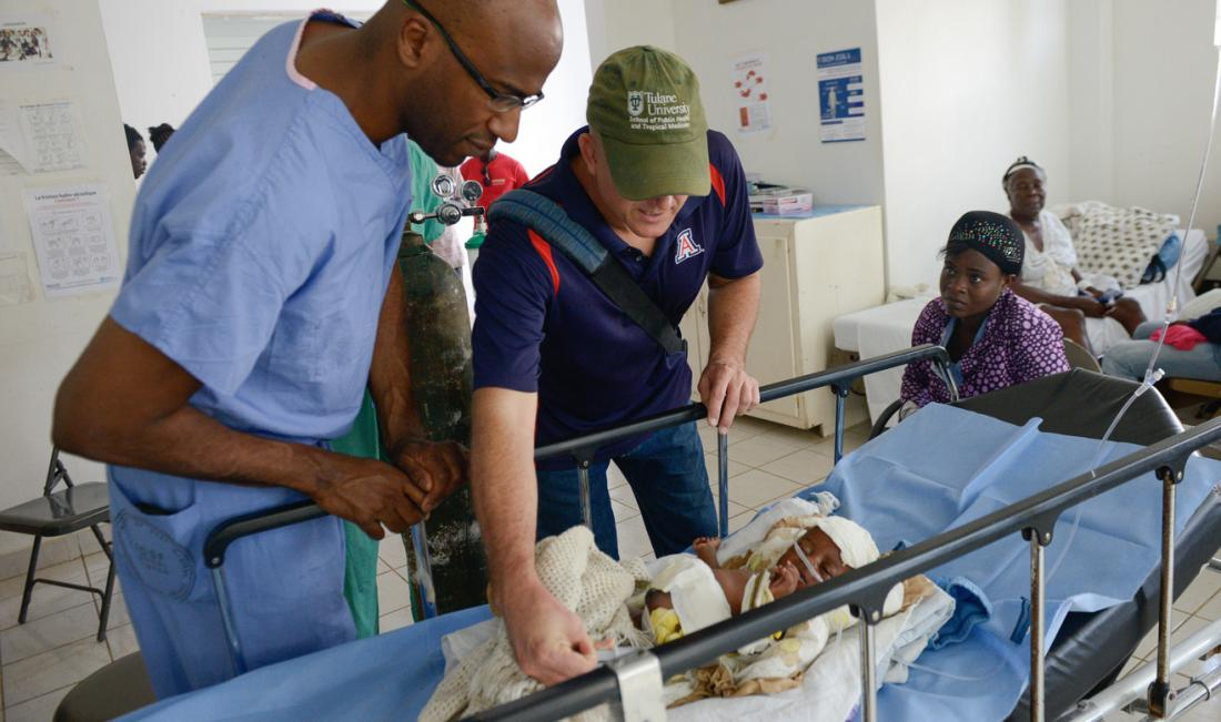 Drs. Ward and Theodore check on baby Lucia
