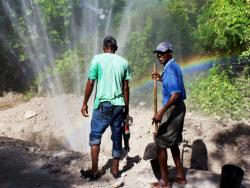 Workers checking a waterline break