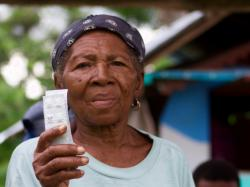 Woman holding cholera medication