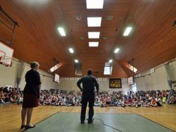 Conor talking at a school assembly at the Lincoln School