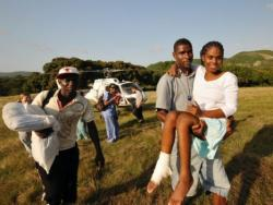 Fabienne Jean (Spinal Cord Injury Patient) being carried off of a helicopter
