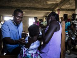 Dr. Bernard examines a patient at the Boko mobile clinic