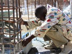 Worker laying bricks for surgical center