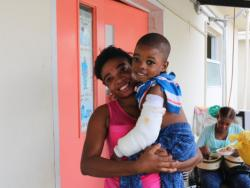 Kimberson and his mom Eveline after Kimberson's surgery