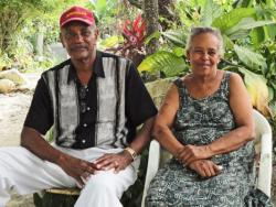 Fond des Blancs residents Jeanine Buissereth and Robert Gachelin sitting