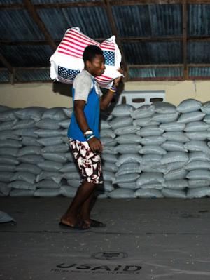 Man holding bag of rice